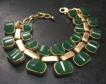 Green and gold thermoset link bracelet.  Great graphic retro statement.