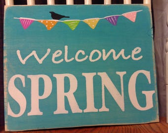 """Spring decor. Welcome spring wood sign. 11 3/4"""" wide x 9 3/4"""" tall. Metal wire hangar on back.  Rustic, wood sign."""