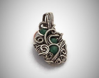 Sterling-silver and silver-filled wire antiqued with 3 emerald beads