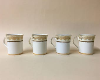 Set of four Elizabethan Swiss Cottage coffee cups