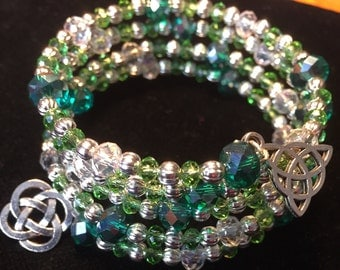 Green and silver memory wire bracelet with celtic charms