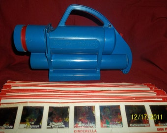 kenner give a show projector- 16  different  color side shows