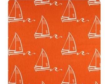 Orange sail boat