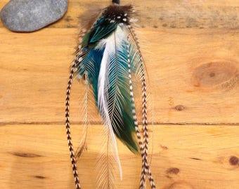 Single  tribal feather earring.