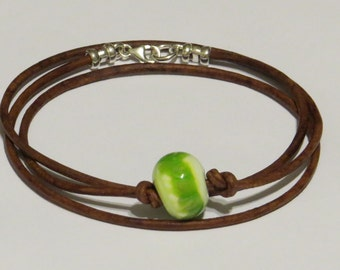 E- 1782 Leather wrap bracelet with handmade glass bead and sterling silver clasp