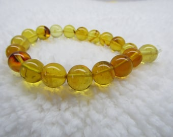Bracelet dominican amber natural green 10.56 MM spheres beads (11.5 GM ) # 9