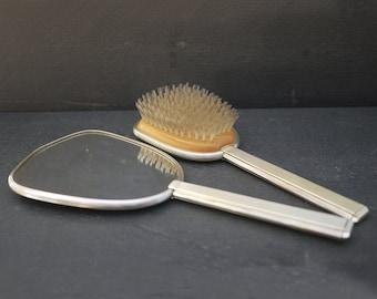 Mirror opposite hand and brush hair of hairdresser. Vintage British Vanity Dresser Set, Shabby Hairbrush and Hand Held Mirror Vanity