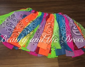 A Infant/Toddler Rainbow Bandana Tutu--Red, orange, yellow, green, blue, indigo, hot pink. Infant and toddler bandana skirts.