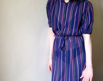 1980s navy blue pin striped semi sheer puffed power sleeved mini dress. Size 6/8/10