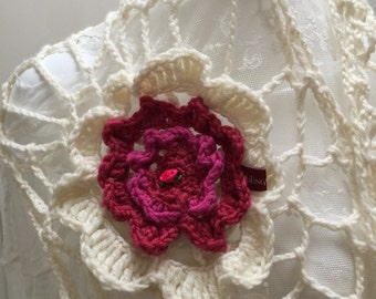 Flower shawl or headdress with a large flower