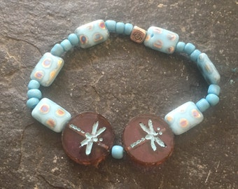 Purple and turquoise Czech glass beaded stretchy bracelet with dragonflies