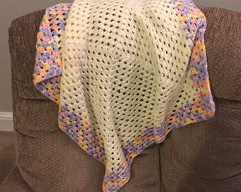 Cream and multicolored baby blanket