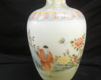 20th Century Peking glass vase decorated with figures in a continuous landscape, 8ins high