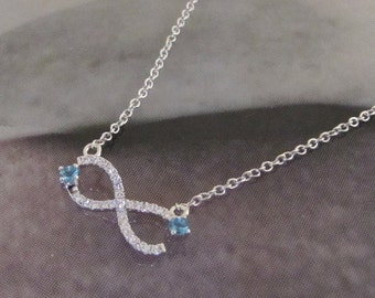 Necklace silver infinity symbol and oxide of Zirconium white and blue
