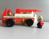 Fisher Price Fire engine 1968 wooden toy and two figures working ladder and bell.