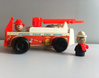 Fisher Price Fire engine, 1968 wooden toy and two figures, working ladder and bell.