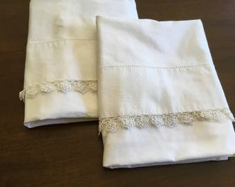 Set of two pillow cases trimmed with tatting.