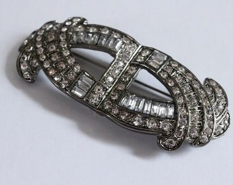 Crystal and Silver Tone Metal Scroll Brooch Pendant