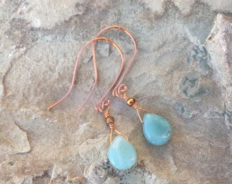 Aquamarine teardrop with single faceted copper glass bead.