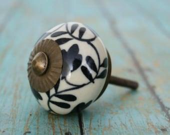 Ceramic Knob with a Black Floral Design