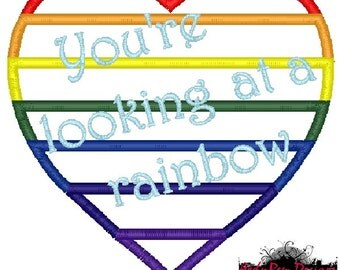 You're looking at a rainbow applique machine embroidery design- rainbow heart- rainbow baby
