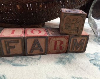 "FARM in antique alphabet blocks, plus the ""barn"" block"