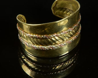 60's cuff bracelet handmade in Brass, with copper and silver twist detail. Boho and retro!