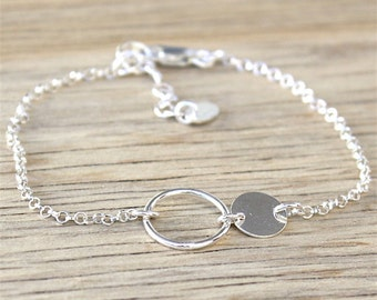 massive ring and silver lozenge bracelet on chain