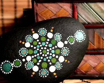 Stone sea hand painted mandala in shades of green.