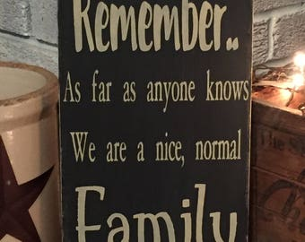 Remember as far as anyone knows we are a nice normal family - primitive distressed sign / shelf sitter