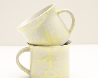 two yellow dripping cups, mugs, shiny, ceramic, handmade, wheel thrown, glazed