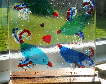 Fused glass blue birds, bubbles and birds, blues and transparent reds kiln formed, fused glass panel and wooden stand.