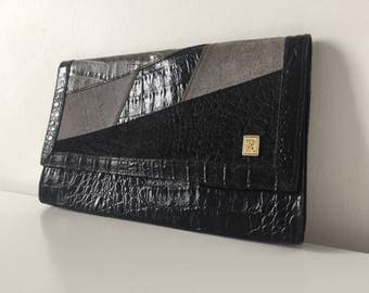 How patchwork croco leather pouch bag