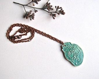 Ceramic necklace turquoise pendant decorated