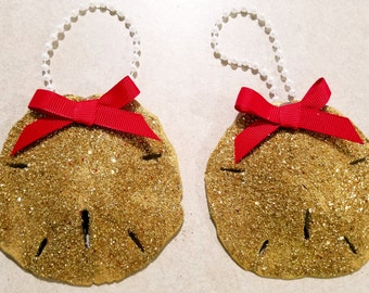 Pair of gold glitter sand dollars