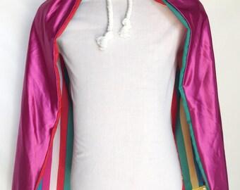 Silky rainbow reversible cape