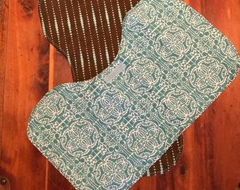 2 brown and teal print contoured burp cloths