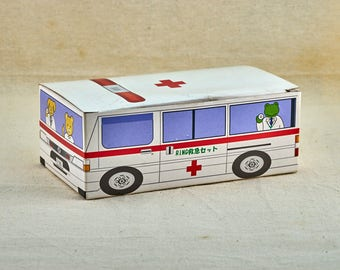Vintage Japanese medical box for kids, contain gauze.