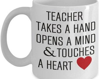Teacher touches a heart - coffee mug gift for teachers
