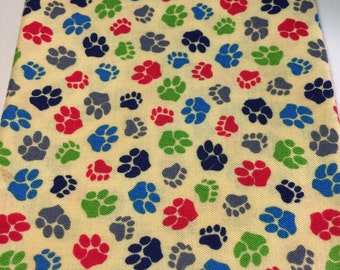 Quilters Fat Quarter of Multi Colored Animal Paws on a Yellow Background
