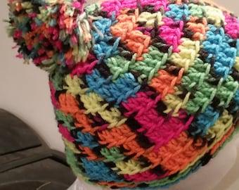 Crocheted neon checkered pom beanie
