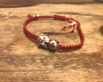 Red macrame knot bracelet with dog charm