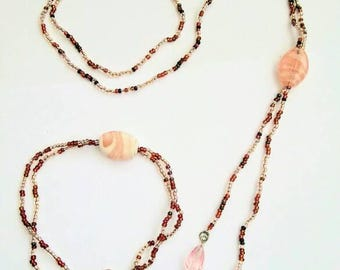 Peach and brown overhead necklace and bracelet.
