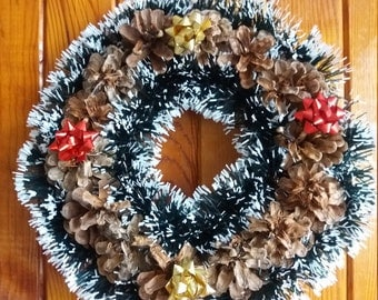 Wreath from cones with garlands and ribbons-handmade