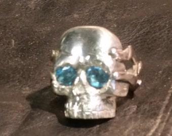 Sterling silver skull ring w/ 2 blue topaz gemstones