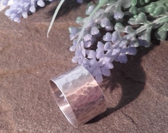 Medium sized hand beaten hammered silver ring