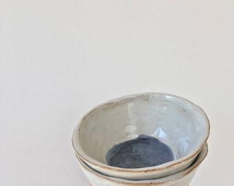 Handmade stoneware ceramic medium white and deep blue bowl