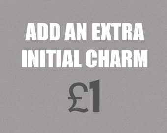 Add an extra initial charm to any charm bracelet