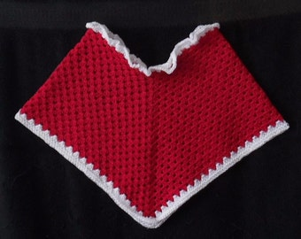Red Baby Poncho with white border.