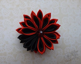 Red and black kanzashi flower brooch